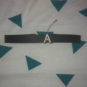 Black choker with A initial
